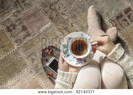 Woman Holding Tea Cup, Top View