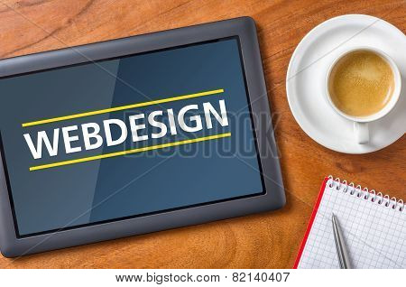 Tablet on a desk with the text Webdesign