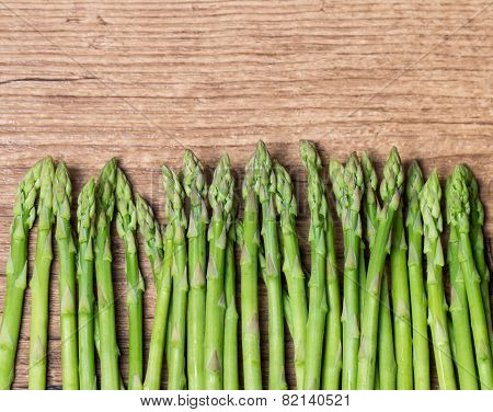 Bunch Of  Asparagus On Wooden Table