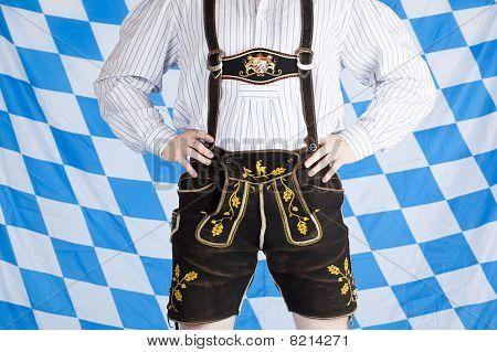 Bavarian man with black Oktoberfest leather pants (Lederhose).