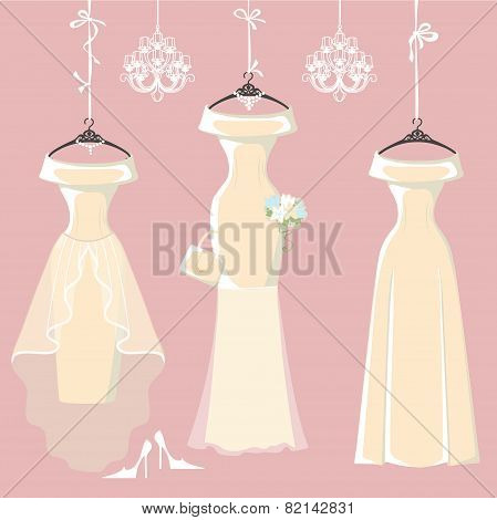 Set of three long bridal dresses hang on ribbons