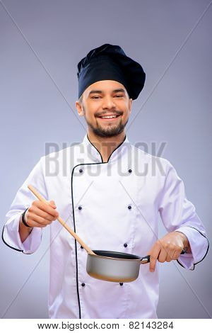 Portrait of young handsome cook