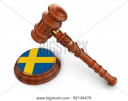 Wooden Mallet and Swedish flag (clipping path included)