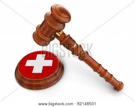Wooden Mallet and Swiss flag (clipping path included)