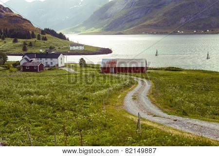 Scenic View Of Fjord, Snow Mountains And Village, Norway, Lofoten