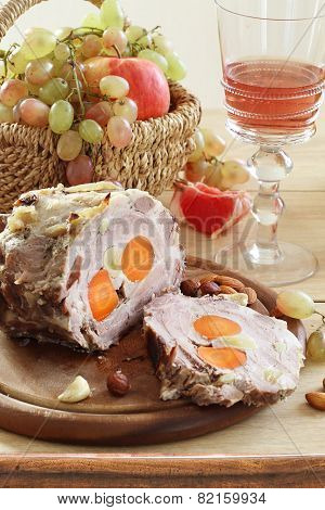 Boiled Pork Filled With Carrots And Garlic And Wine In A Transparent Glass