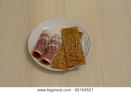 Thin Slices Of Prochutto Ham With Rye Crisps