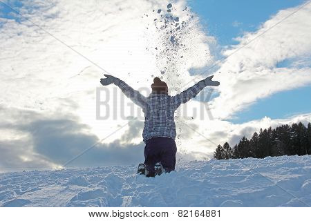 Teenage Girl Throwing Snow