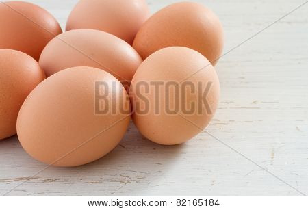 Brown eggs on a white shabby table