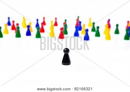 Several Game Pawns In Different Colors On A White Background.