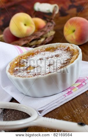 Tart With Jam Of Peaches And Icing Sugar At The Wooden Backgroun