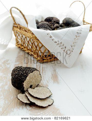 Cut Black Truffle On Old Table