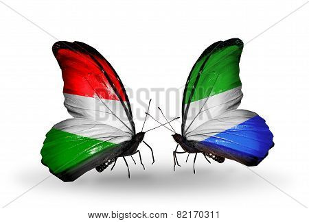 Two Butterflies With Flags On Wings As Symbol Of Relations Hungary And Sierra Leone