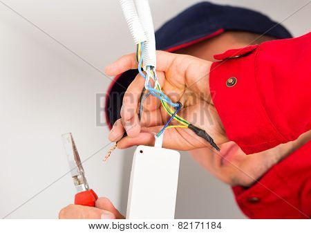 Close-up Of Electrician During Work