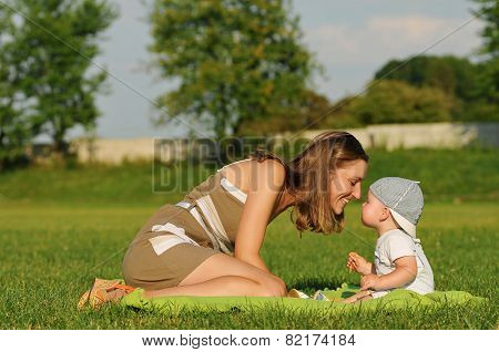 Happy Young Woman With Child