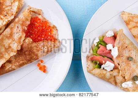 Thin pancakes, crepes with red caviar and salmon