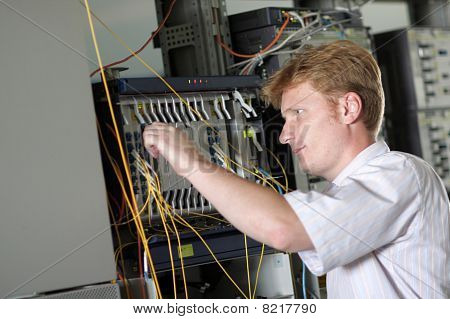 Engineer Adjusts Multiplexer