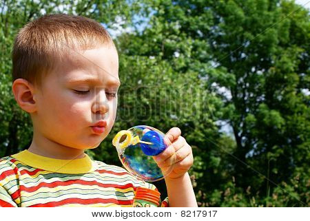 A child blowing bubble