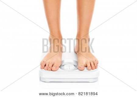 A picture of woman feet on bathroom scales over white background