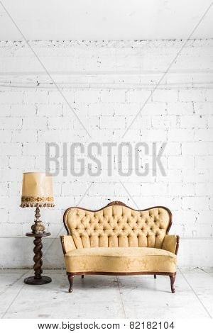 Brown Classical style Armchair sofa couch in vintage room with desk lamp