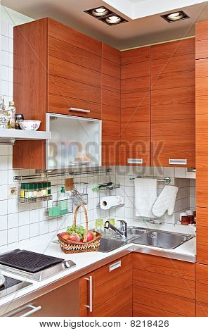 Part Of Kitchen Interior With Wooden Furniture And Sink