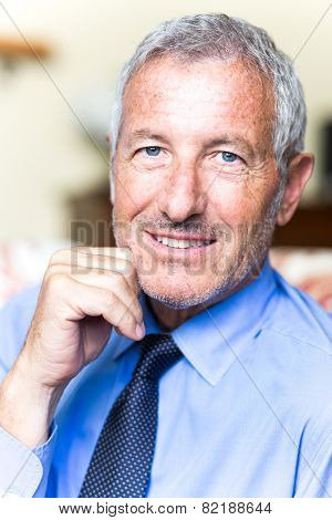 Successful mature handsome businessman looking confident