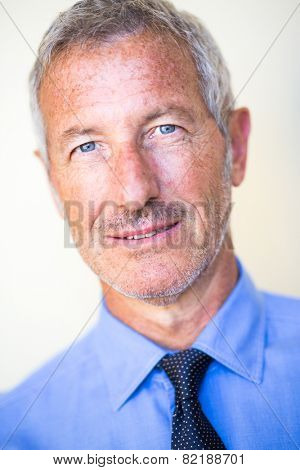 Close up portrait with shallow depth of field of a rich successful handsome businessman