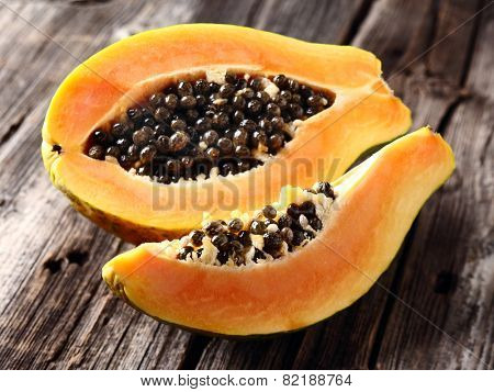 Ripe papaya in a wooden background