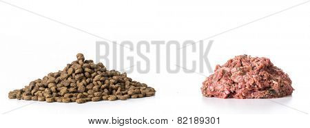 kibble and raw pile of food isolated on white background