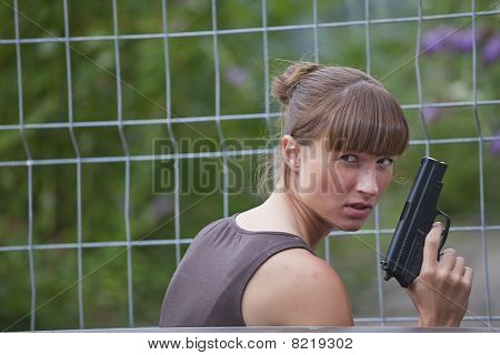 Female Agent With Gun Hiding