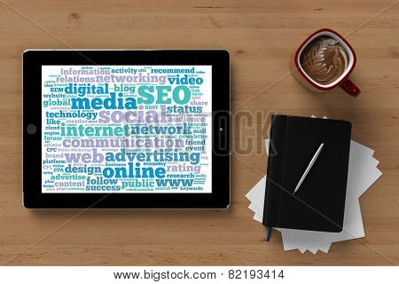 Online Marketing tag cloud on tablet computer on a desktop (3D Rendering)