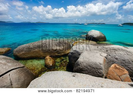 Stunning beach with unique huge granite boulders, turquoise ocean water and blue sky at Virgin Gorda, British Virgin Islands in Caribbean