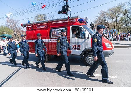 Employees and car of fire department on parade