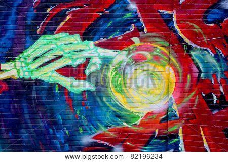 Street art Montreal skeleton hand
