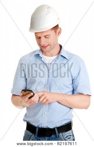 Contractor in hardhat using his cell phone.