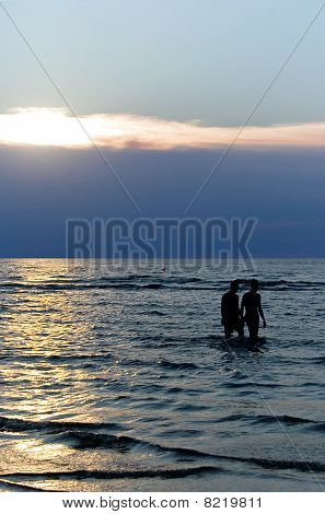 Two silhouettes ashore the Baltic sea