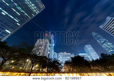 Hong Kong skyline in night with skyscrapers against sky.