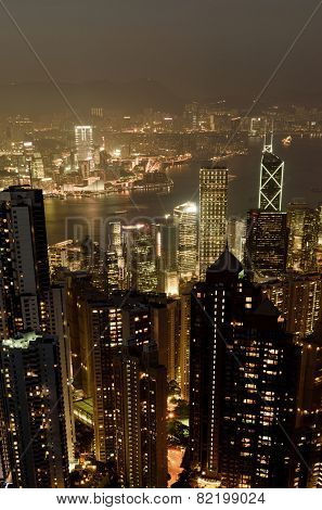 Hong Kong city skyline with modern skyscrapers in night.