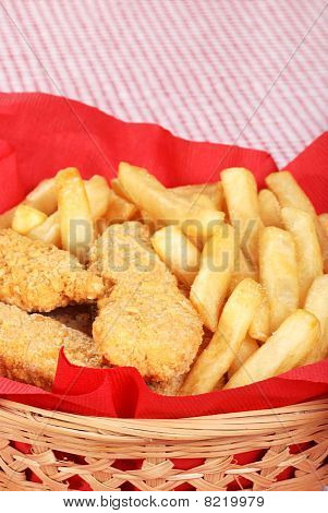closeup chicken fingers and french fries