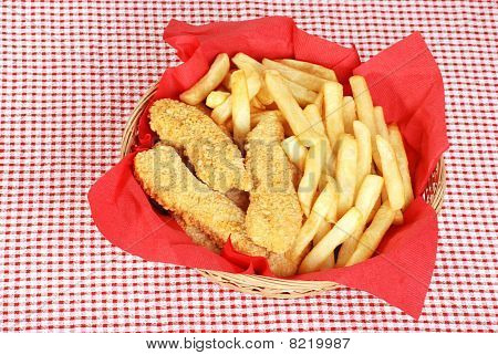 top view chicken fingers and french fries