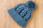 picture of knitted cap  - the knitting cap on the wooden background - JPG