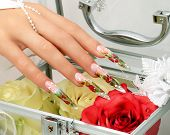 foto of nail-design  - Female hand with manicure  and beautiful design on  nails - JPG