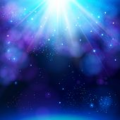 stock photo of twinkle  - Sparkling blue festive star burst background with a dynamic bright white explosion of rays of light over a twinkling bokeh with copyspace for your greeting or text - JPG