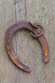 stock photo of horseshoe  - old horseshoe on wood as symbol for luck