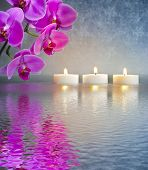 foto of mirror  - Japanese ZEN garden with candle lights and orchid flower mirroring in water - JPG