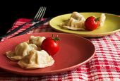 picture of no clothes  - Chinese jiaozi with tomato on green and red plates - JPG