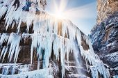 picture of water jet  - Icicles and a jet of water on the frozen waterfall - JPG