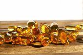 picture of prophylactic  - dietary supplement pills on wooden desk - JPG
