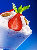 stock photo of strawberry  - Strawberry cream in a glass garnished with strawberries almonds and fresh mint  - JPG