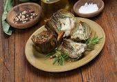 stock photo of artichoke hearts  - Artichoke hearts on a plate on the old wooden table - JPG